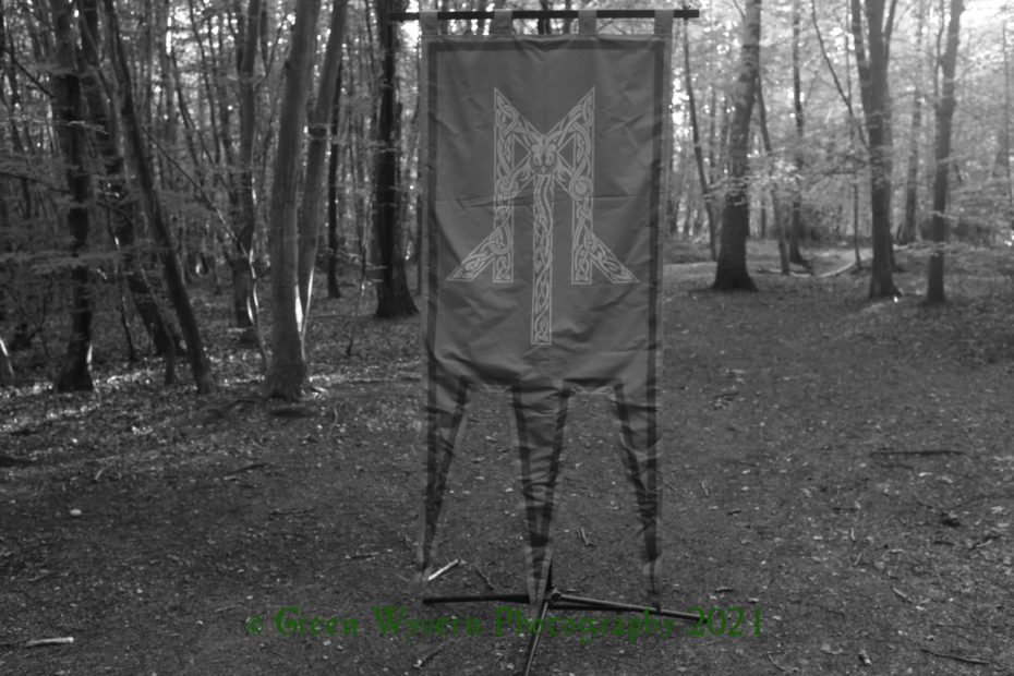 banner showing Wolcensmen logo in the woods